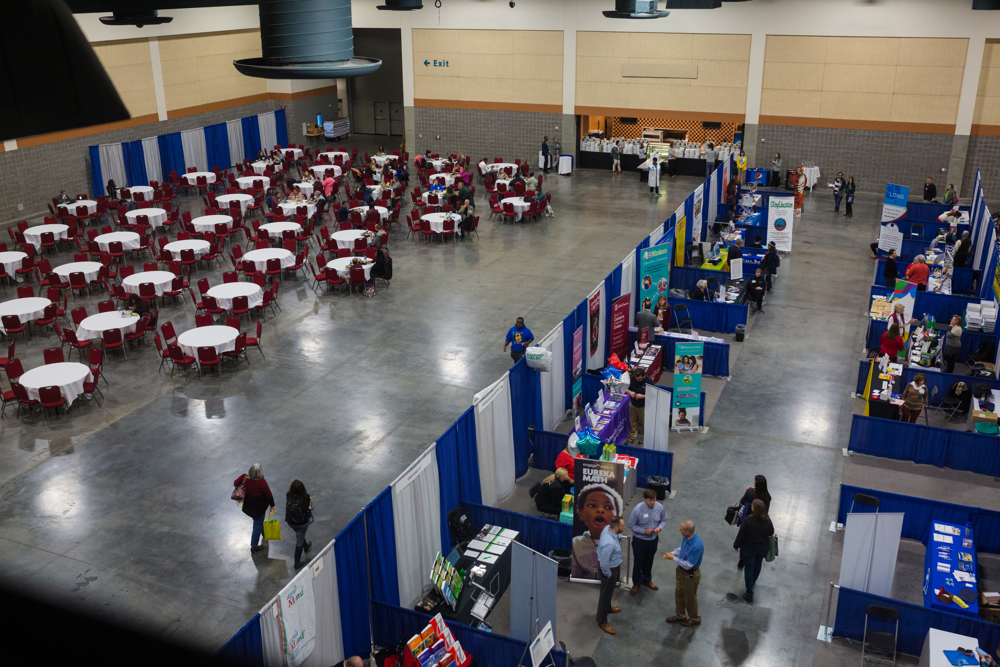 An overhead shot of the Exhibit Hall, doubling as a vendor exhibition space and lunch room